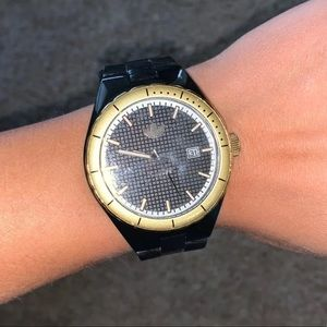 Adidas gold and black watch